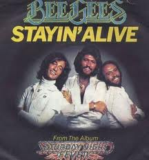 Bee Gees - Staying Alive lyrics